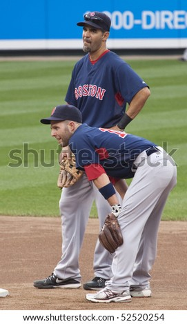 BALTIMORE - MAY 1: Dustin Pedroia and Mike Lowell of the Boston Red Sox chat at second base before a game at Camden Yards on May 1, 2010 in Baltimore, Maryland - stock photo
