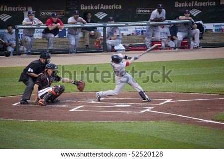 BALTIMORE - MAY 1: Dustin Pedroia of the Boston Red Sox swings at a pitch during a game at Camden Yards on May 1, 2010 in Baltimore, Maryland - stock photo