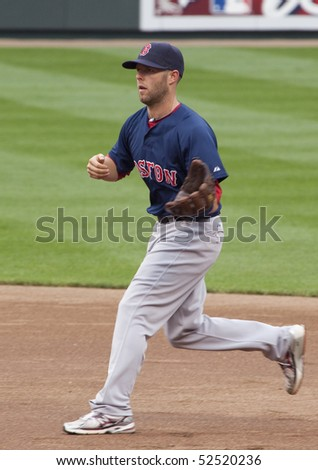 BALTIMORE - MAY 1: Dustin Pedroia of the Boston Red Sox takes ground balls before a game at Camden Yards on May 1, 2010 in Baltimore, Maryland - stock photo
