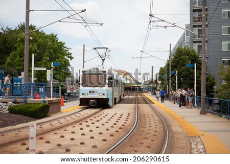 Baltimore, MD - July 19, 2014. Baltimore Light Rail vehicle pulls into a station.  - stock photo
