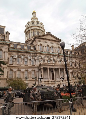 BALTIMORE, MD - MAY 1, 2015: The National Guard surrounds the City Hall  building in Baltimore, MD, on May 1, 2015, during a week of citizen protests and riots against police brutality.  - stock photo