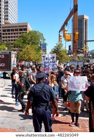BALTIMORE, MD - SEPTEMBER 12: Young people hold anti Donald Trump signs at a protest downtown on September 12, 2016 in Baltimore, MD.