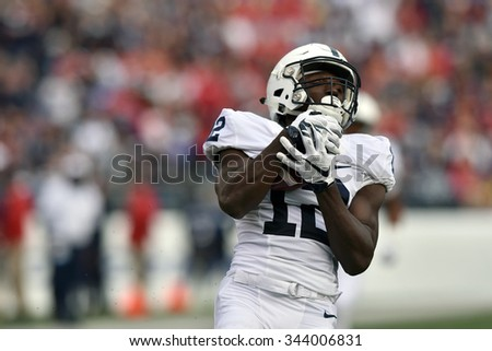 BALTIMORE - OCTOBER 24: Penn State Nittany Lions wide receiver Chris Godwin (12) hauls in a long pass during the NCAA football game against Maryland October 24, 2015 in Baltimore.  - stock photo