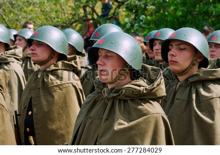 BALTIYSK, RUSSIA - MAY 9, 2015: Celebrating the 70th anniversary of the Victory Day (WWII), Soviet soldiers in helmets and cloaks - stock photo