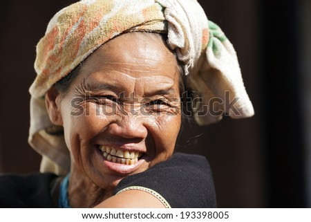BAM MUANG PAM, THAILAND, NOVEMBER 22 : close portrait of a mature Karen tribe woman laughing, Thai ethnicity, in the village of  Bam Muang Pam, north Thailand on November 22, 2012 - stock photo