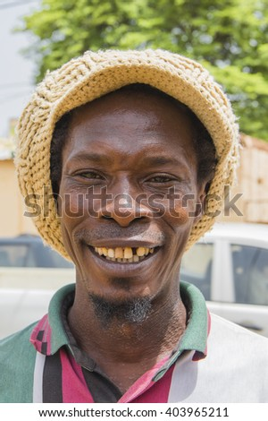 BAMAKO, MALI - 20 July 2015: An image smiling african guy standing outside