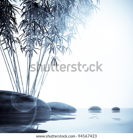 Bamboo and stones on the water - stock photo
