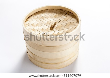 bamboo basket for steaming on white background - stock photo