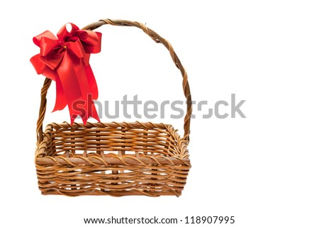 Bamboo basket isolated on white background Decorated with red ribbons on top - stock photo