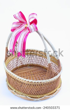 bamboo basket with ribbon on white background