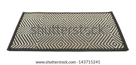 Bamboo black straw serving mat with a golden thread ornament isolated over white background