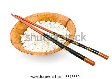 Bamboo bowl with rice and chopsticks isolated on white - stock photo