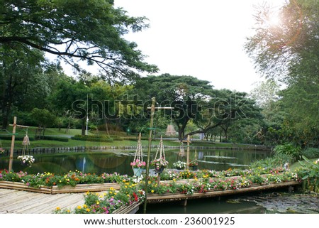 bamboo bridge with flower in garden - stock photo