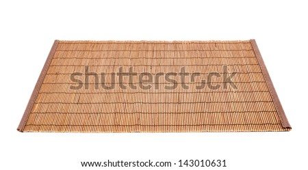 Bamboo brown straw serving mat isolated over white background