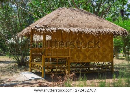 Bamboo bungalows in resort area of Thailand - stock photo
