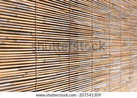 Bamboo curtain for use as nature background - stock photo