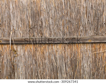Bamboo fence with wooden plank background - stock photo