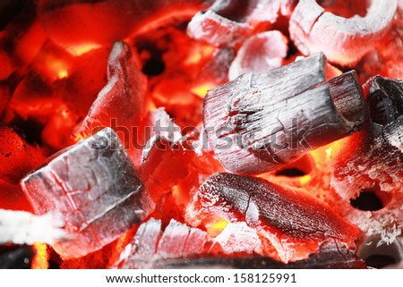 Bamboo Fire coals in stove for cooking - stock photo