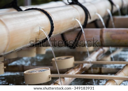 Bamboo fountain for wash face and hands before get inside Japanese temple.  - stock photo