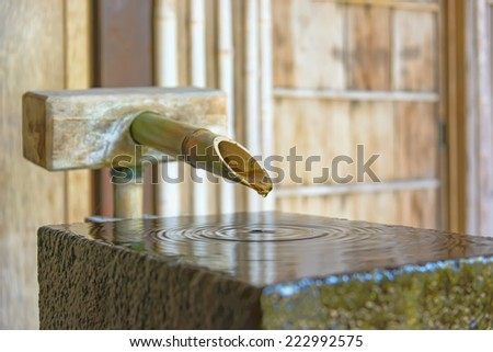Bamboo Fountain in Nomura-ke Samurai house. Nomurake is a restored samurai residence with a beautiful, small garden. The house displaying the lifestyle of the era when samurai were prosperous. - stock photo