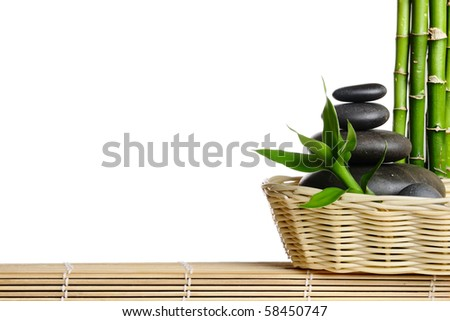 Bamboo frame with stones on the mat - stock photo