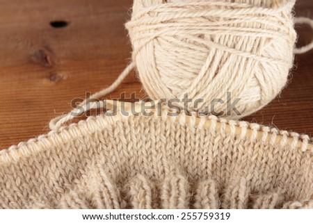 bamboo knitting needles in process of knitting - stock photo