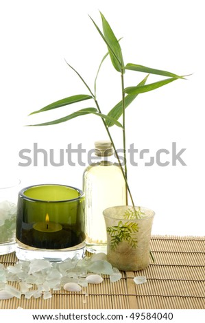 Bamboo leaf in vase ,candle, salt in a spa