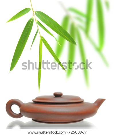 Bamboo leaves and teapot in white background