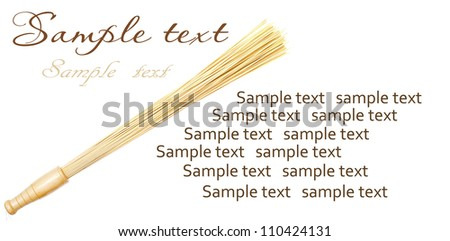 Bamboo massage broom isolated on white