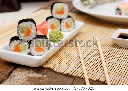 Bamboo mat and sushi on a plate - stock photo