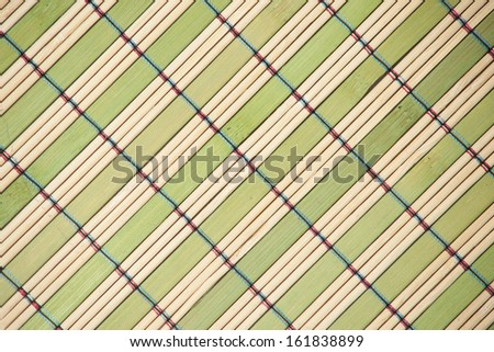 Bamboo mat background. The asian mat from yellow and green bamboo - stock photo