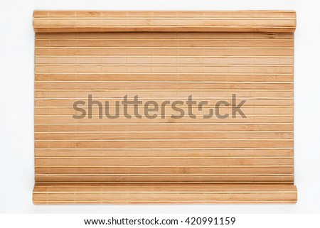 Bamboo mat twisted in the form of a manuscript, on a white background - stock photo