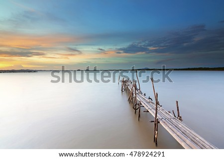 Bamboo pier bridge at beautiful sunset. soft focus due to long exposure