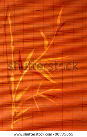 Bamboo place mat with handdrawn image of bamboo plant. Ideally as background. - stock photo