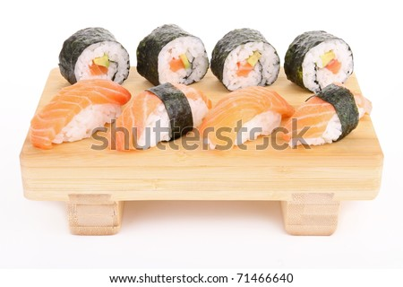 bamboo plate of sushi and maki on white background