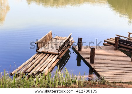 Bamboo raft in lagoon for travel - stock photo
