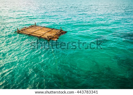 Bamboo raft is floating in a blue lagoon