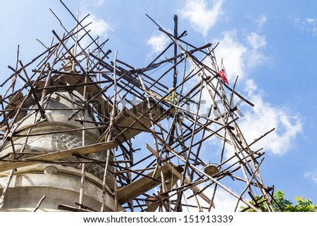 Bamboo scaffolding for reconstruction Pagoda in the temple in Nong Khai, Thailand. - stock photo