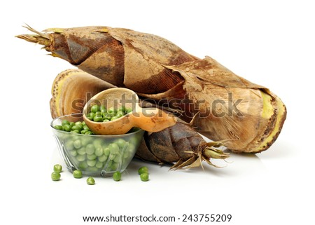 Bamboo shoot and peas on the white background  - stock photo