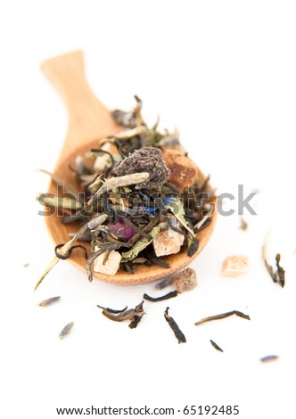 Bamboo Spoon Filled with Serving Size of White Tea Leaves with Lavender - stock photo