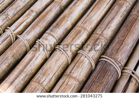 Bamboo sticks with a rope background - stock photo
