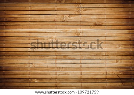 Bamboo sticks wooden background with thread uniting - stock photo