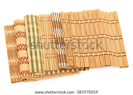 Bamboo straw serving mat isolated over white background, set of  - stock photo