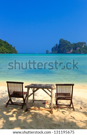 Bamboo table and chairs on beautiful bay of Koh Phi Phi  Thailand - stock photo