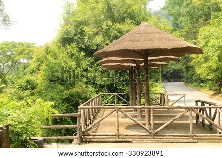bamboo thatch pavilion at the viewpoint on top of the mountain