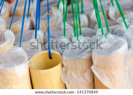 Bamboo tube  container for drinking water - stock photo