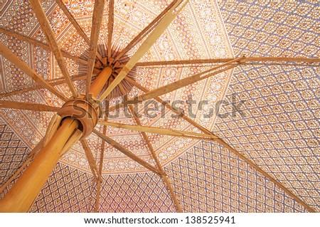 bamboo umbrella and Lanna cloth, thai traditional bamboo umbrella made in Thailland - stock photo