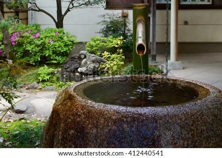 bamboo water fountain in a Japanese garden  - stock photo