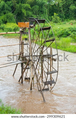 Bamboo water wheel. The use of water power for irrigation at Pai district Mae Hong Son Province ,Thailand - stock photo