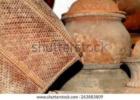 Bamboo weave & clay pot - stock photo